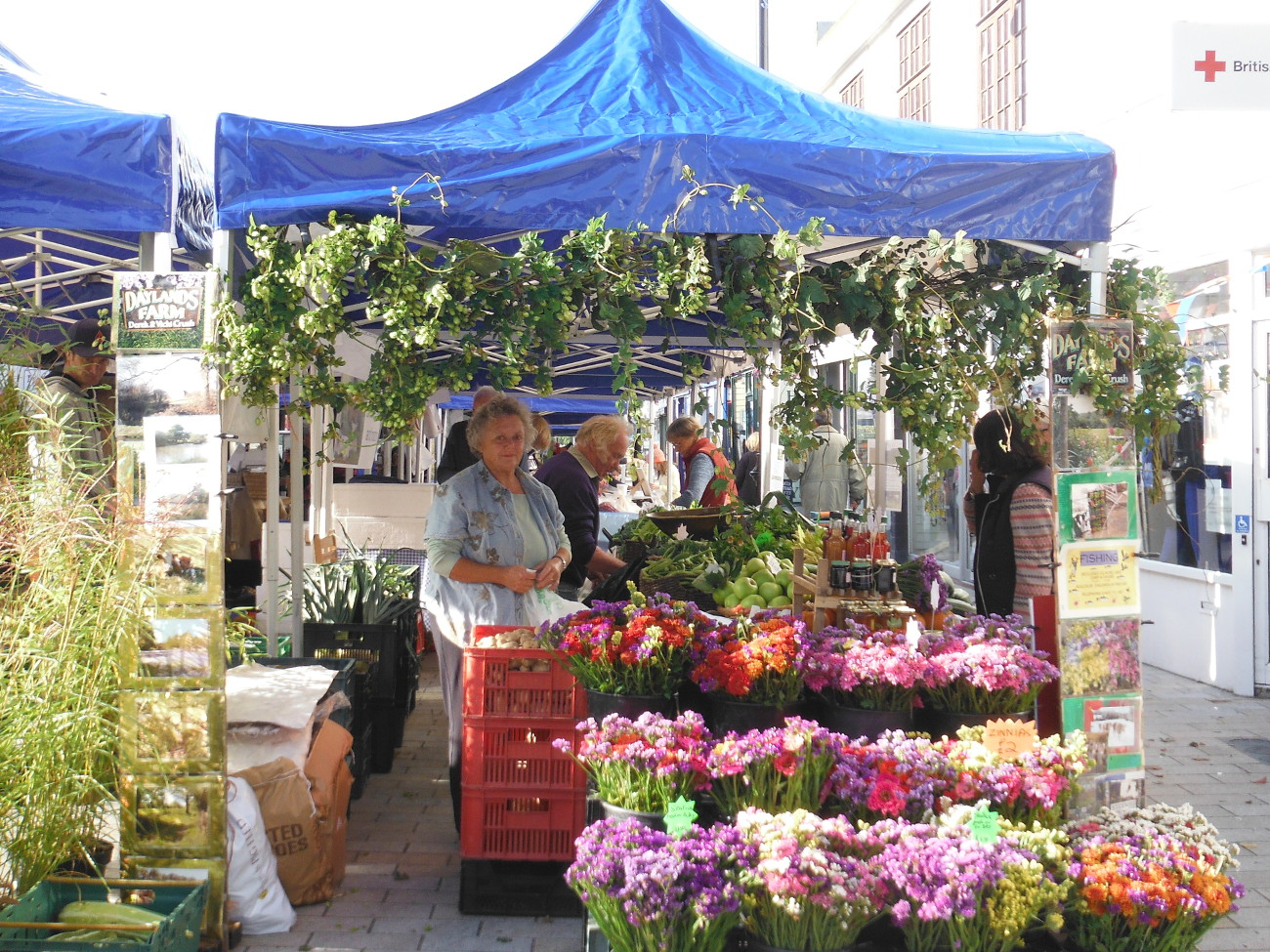 Vicki selling flowers on the stall at farmers' market